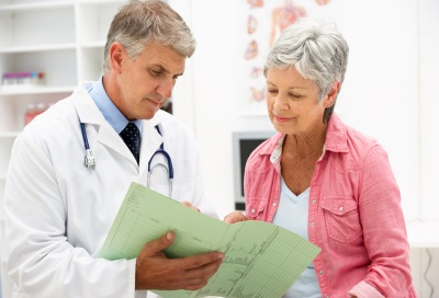 Doctor with patient providing consultation.